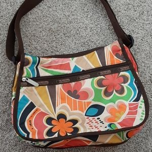 Lesportsac floral vibrant colored crossbody bag